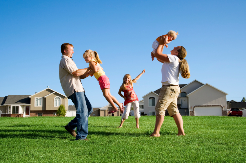 family playing in lawn turf grass
