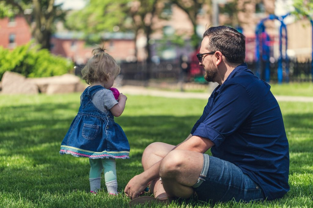 Father and daughter in lawn
